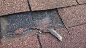 Leaking tab in a roof shingle