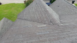 Missing shingles from wind damage.