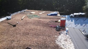 Existing tar and gravel roof with old repairs and several leaks.