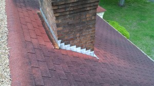 Before picture of brick chimney with old flashing and no cricket/diverter installed.