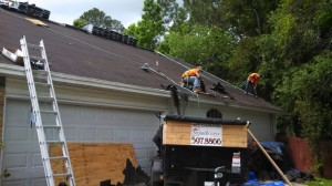 Part of the crew removing old shingles.