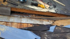 "Removal of existing siding revealed that the wall flashing only had a 1"" vertical turn-up."