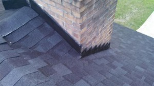 After chimney cricket/diverter installation and new flashing.