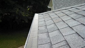 Gutter screens with hail damage