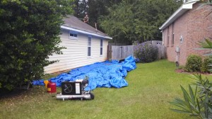 Tarps laid around house