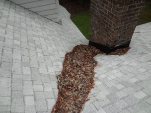 Debris in a valley will decrease the shingle life by retaining moisture.